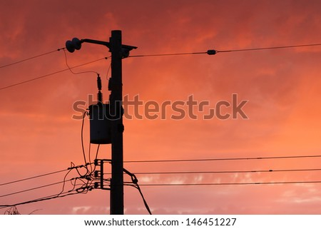 Telephone Pole at Sunset - stock photo