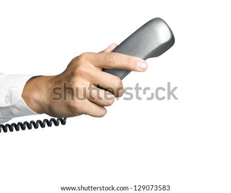 Telephone receiver in hand isolated on white background - stock photo