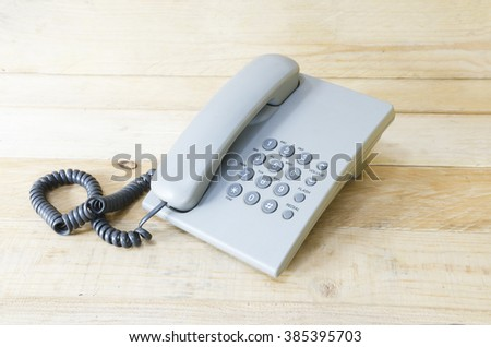 telephone selective focus with wood background - stock photo