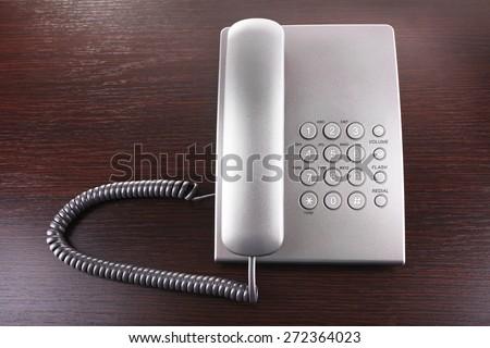Telephone set on wooden background - stock photo