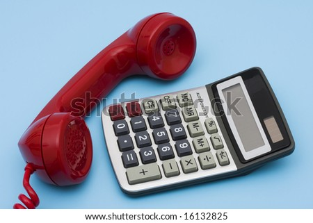 Telephone with calculator, help with your financial questions - stock photo