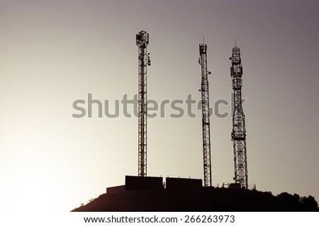 telephony antennas at sunset - stock photo
