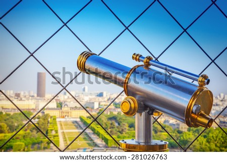 Telescope at Eiffel Tower - stock photo