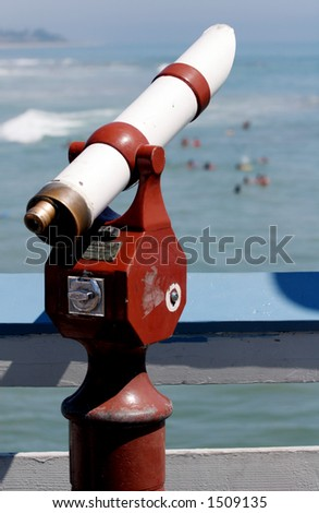 Telescope at the beach. - stock photo
