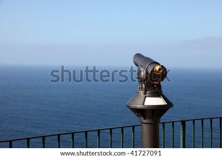 Telescope at the sea - stock photo