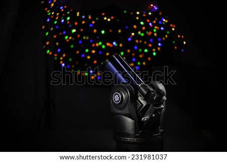 Telescope on  black and Stars background - stock photo