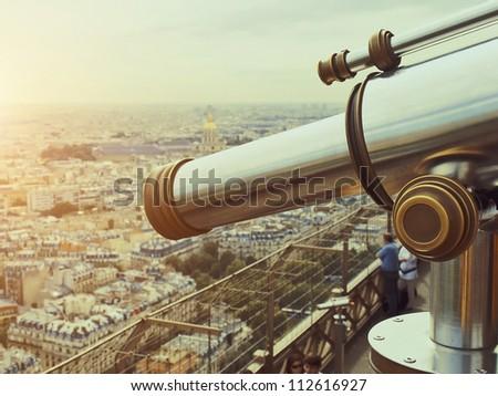 Telescope on top floor of Eiffel Tower in Paris - stock photo