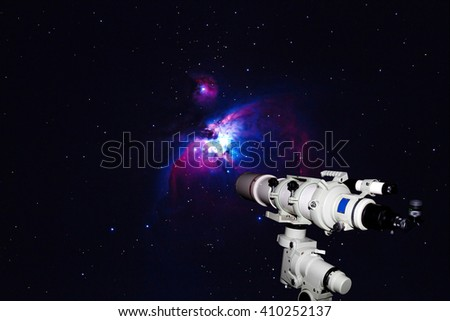 Telescope watching the Great Orion Nebula, M42, NGC1976 on dark night (Deep Sky Objects ),blurry and soft focus. - stock photo
