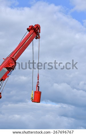 Telescopic boom truck lifted a tank in a sunny day  - stock photo