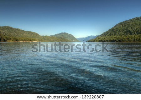 Teletsky mountain lake in Altay (Russia) with clear blue summer sky - stock photo