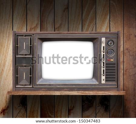 television on wood shelf - stock photo