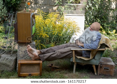 television viewers sleeping at football - stock photo