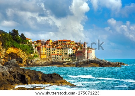 Tellaro rocks and old village on the sea. Church and houses. Five lands, Cinque Terre, Liguria Italy Europe. - stock photo