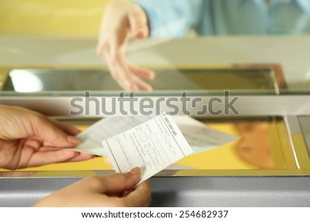 Teller window with working cashier. Concept of payment of utilities - stock photo
