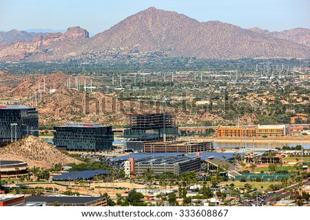 Tempe, Arizona USA-October 27, 2015:  Aerial view from above the campus of Arizona State University showing growth along the Tempe Town Lake continuing with the addition of State Farm's buildings. - stock photo