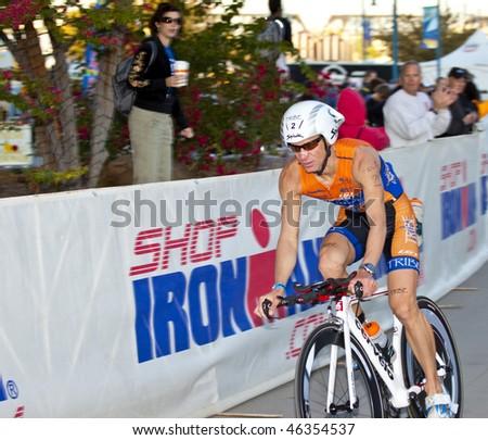 TEMPE, AZ - NOV. 22:  Jozsef Major in the cycling stage of the Phoenix Ironman Triathlon on November 22, 2010 in Tempe, Arizona. - stock photo