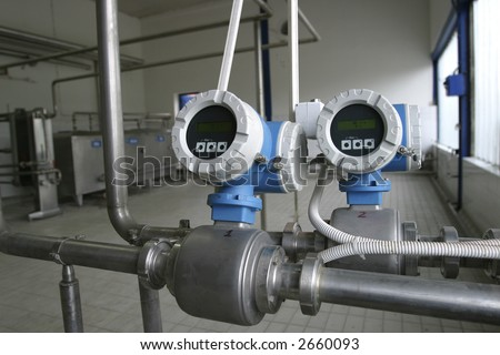 temperature control valves in dairy production factory - stock photo