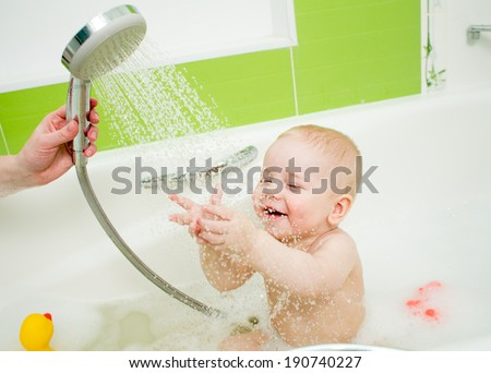tempering shower for baby - stock photo