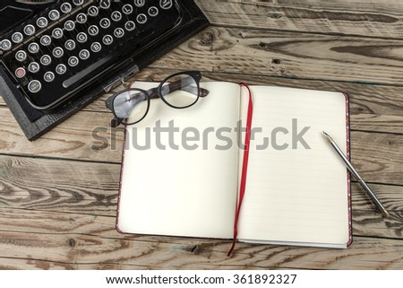 Template mockup copyspace empty white paper  place for your text. Blank open notebook and old fashioned typewriter on wooden table. Theme Writers Editors Journalists Publishers storytellers novelists - stock photo