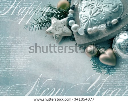 Template of the Christmas card. Holiday background with star, heart, fir-tree branches, Christmas toys, a blank space for your text. - stock photo