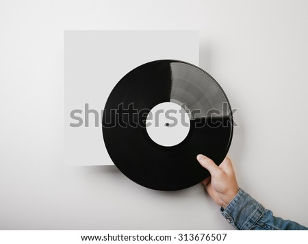 Template of vinyl cover on white wall background - stock photo