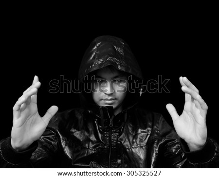 template portrait photo of asian handsome male magician, wizard create your copy space between hands. isolated on black for background - stock photo