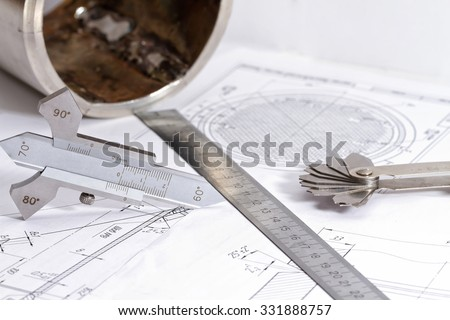 Templates for measuring the bevel edge during the preparation of the welded joints, measuring the height of the reinforcement bead and fillet weld leg are on the detail drawing - stock photo