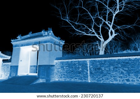 Temple gate in the Zhengjue temple in Old summer palace ruins park, Beijing, China - stock photo