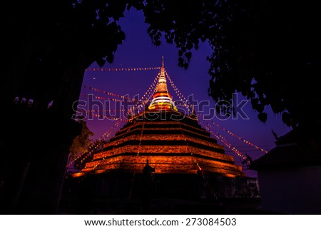 Temple in Thailand is named Wat Ratchaburana silhouette on sunset sky - stock photo