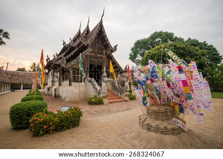 Temple in the evening during the Songkran festival, Thailand - stock photo