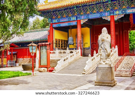 """Temple of Confucius at Beijing is the second largest Confucian Temple in China. Translation inscription """"Big Xu Gate"""",under monument translation-""""Statue of Confucius, the great Chinese philosopher """". - stock photo"""