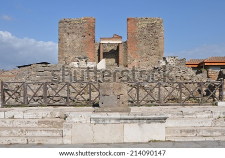 Temple of Fortuna Augusta in ancient Pompeii, Italy. Looking east from Via del Foro. - stock photo