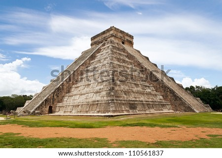 Temple of Kukulkan, a Mesoamerican step-pyramid that dominates the center of the Chichen Itza archaeological site in the Mexican state of Yucatan, Mexico - stock photo