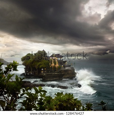Temple of Tanah Lot the Indonesian island of Bali in a storm - stock photo