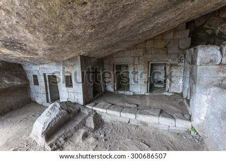 Temple of the Moon at the bottom of Wayna Picchu in Machu Picchu, was designed Peruvian Historical Sanctuary in 1981 and a World Heritage Site by UNESCO in 1983. - stock photo