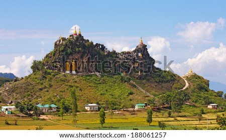 temple on top of a mountain with golden statues, Myanmar(Burma), november 2014 - stock photo