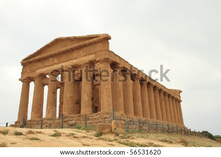 Temple Valley, Agrigento, Sicily, Italy. The greek temple of Concord facade with its columns under restoration. - stock photo