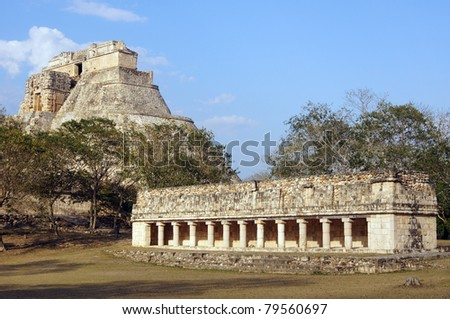 Temple with colonnade and pyramid in Uxmal, Mexico - stock photo
