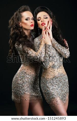 Temptation. Two Flirtatious Sexy Women Touching Each Other - stock photo