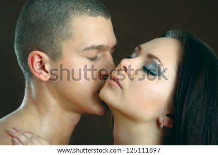 temptation woman and man, isolated on black background - stock photo