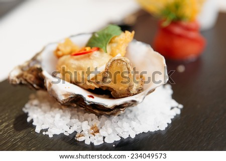Tempura fried oyster in shell, delicious appetizer - stock photo