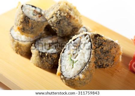 Tempura Maki Sushi - Deep Fried Roll made of Cucumber and Cream Cheese inside - stock photo