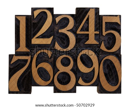 ten arabic numerals 0-9 in vintage wood letterpress blocks stained by black ink, flipped horizontally, isolated on white with clipping path - stock photo