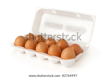 Ten brown eggs in a plastic package - stock photo