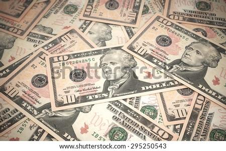 Ten dollar banknotes stacks close-up (depth of field) - stock photo
