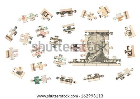 Ten dollars jigsaw - stock photo