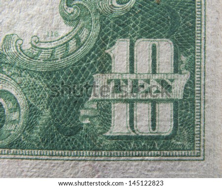 Ten 10 dollars US Currency close up macro of number ten on ten dollar bill - stock photo