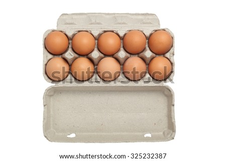 Ten eggs on a tray isolated on white background