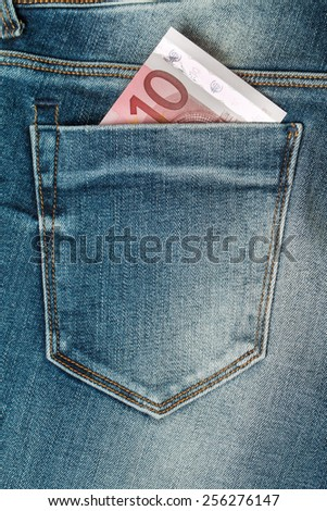ten euro banknote in the jeans pocket - stock photo