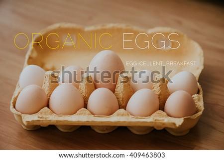 Ten fresh organic eggs, egg carton detail, one giant egg - stock photo